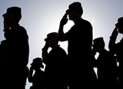 Silhouette of Solders Saluting